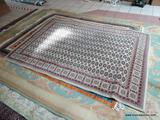 MACHINE MADE BOKHARA STYLE RUG IN IVORY, RED, AND BEIGE. MEASURES APPROXIMATELY 5 FT 3 IN X 7 FT 7