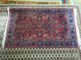 HANDMADE TIGHTLY WOVEN BOKHARA IN MAUVE, BLUE, AND IVORY. MEASURES APPROXIMATELY 3 FT 1 IN X 5 FT 2