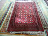 HAND KNOTTED SILKY BOKHARA IN MAROON, IVORY, AND BLUE. MEASURES APPROXIMATELY 4 FT 2 IN X 5 FT 6 IN.