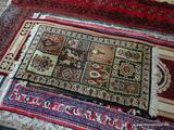MACHINE MADE COURISTAN ORIENTAL STYLE RUG IN BLUE, IVORY, AND BEIGE WITH FLOWERS AND ANIMALS.