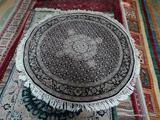 HAND KNOTTED ROUND PERSIAN IN BLACK, IVORY, AND SAGE. MEASURES 4 FT 2 IN DIA. ITEM IS SOLD AS IS