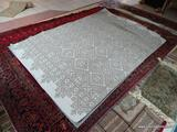 MACHINE MADE DESIGNER RUG IN GRAY AND WHITE. MEASURES APPROXIMATELY 5 FT X 7 FT. ITEM IS SOLD AS IS