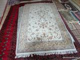 HAND TUFTED ORIENTAL STYLE RUG IN IVORY, SAGE, AND RED. MEASURES APPROXIMATELY 6 FT X 8 FT 2 IN.