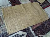 BRAIDED LEATHER RUG. MEASURES APPROXIMATELY 2 FT 6 IN X 4 FT 1 IN. ITEM IS SOLD AS IS WHERE IS WITH