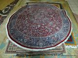 ROUND PERSIAN RUG IN RED, BLUE, AND IVORY. MEASURES APPROXIMATELY 8 FT IN DIA. ITEM IS SOLD AS IS
