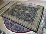MACHINE MADE PERSIAN STYLE RUG IN BLACK, IVORY, SAGE. MEASURES 5 FT 3 IN X 7 FT 9 IN. ITEM IS SOLD