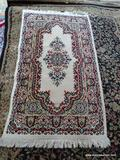 MACHINE MADE ORIENTAL STYLE RUG IN IVORY, RED, AND SAGE. MEASURES APPROXIMATELY 2 FT 7 IN X 4 FT 11