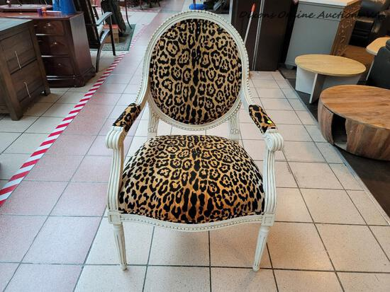 (R1) MODERN LEOPARD PRINT UPHOLSTERY AND CREAM ARMCHAIR WITH UPHOLSTERED BACK, SEAT, AND ARMS. ITEM