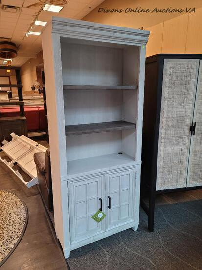 (R1) CARAWAY DOOR BOOKCASE FROM THE CARAWAY COLLECTION BY ASPENHOME. RETAILS FOR $819 ONLINE!