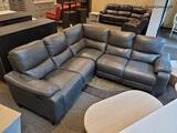 (R3) LEATHER ELECTRIC RECLINING SECTIONAL SOFA IN GRAY. SIMILAR ITEMS RETAIL FOR $3,499 ONLINE!