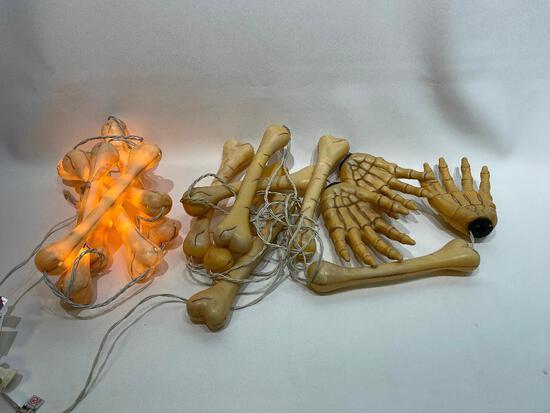 (10J) VINTAGE PLASTIC LIGHTED BONES CREEPY GRAVEYARD HALLOWEEN DECORATION. ONE STRING NOT