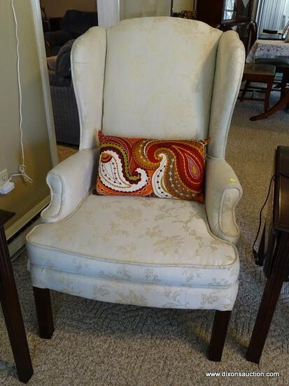 """(FR) CREAM COLORED UPHOLSTERED WINGBACK CHAIR WITH BLOCK LEGS. MEASURES APPROX. 29"""" X 27"""" X 33""""."""