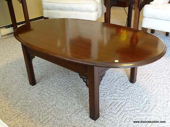"""(FR) OVAL COFFEE TABLE WITH REEDED LEGS. MEASURES 43-1/2"""" X 27-1/2"""" X 16""""T."""
