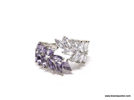 .925 STERLING SILVER LADIES 5 CT COCKTAIL RING. SIZE 8. ITEM IS SOLD AS IS WHERE IS WITH NO