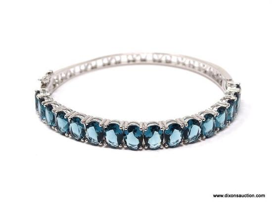 .925 STERLING SILVER LADIES 16 CT BLUE TOPAZ BANGLE. ITEM IS SOLD AS IS WHERE IS WITH NO GUARANTEES
