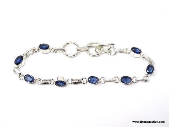 .925 STERLING SILVER LADIES 4 CT TANZANITE BRACELET. ITEM IS SOLD AS IS WHERE IS WITH NO GUARANTEES