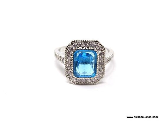 .925 STERLING SILVER LADIES 2-1/2 CT BLUE TOPAZ RING. SIZE 8. ITEM IS SOLD AS IS WHERE IS WITH NO