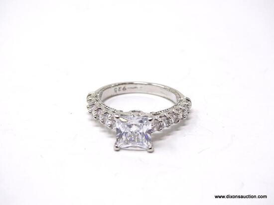 .925 STERLING SILVER LADIES 2 CT ENGAGEMENT RING. SIZE 7. ITEM IS SOLD AS IS WHERE IS WITH NO