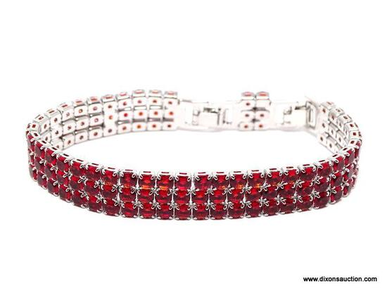.925 STERLING SILVER LADIES 19 CT GARNET BRACELET. ITEM IS SOLD AS IS WHERE IS WITH NO GUARANTEES OR