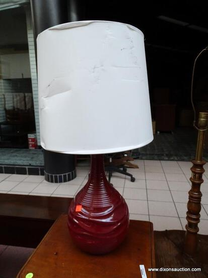 (R1) RED VASE STYLE LAMP WITH PAPER SHADE. MEASURES 25 IN TALL. SHADE HAS SOME DENTING. ITEM IS SOLD