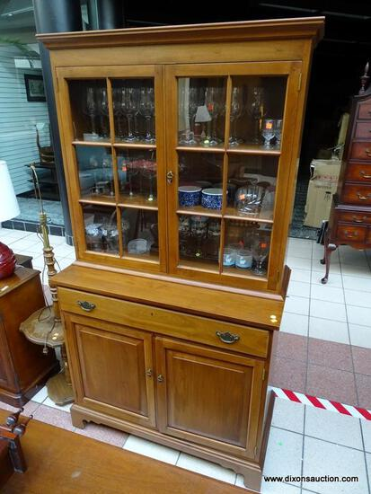 (R1) SUTERS 2 PIECE CHINA CABINET WITH 2 GLASS PANELED DOORS AND A SINGLE DRAWER OVER 2 WOOD PANELED