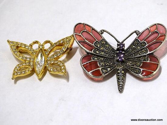 (SC) PAIR OF BUTTERFLY THEMED BROOCHES. 1 IS SILVER TONED AND 1 IS GOLD TONED. ITEM IS SOLD AS IS,