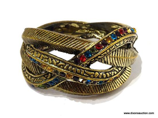 (SC) BRASS BRACELET WITH MULTI-COLORED GEMS STONES AND SPRINGLOADED LATCH. ITEM IS SOLD AS IS, WHERE