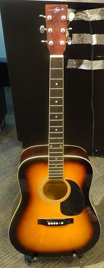 (SC) JAY JR. ACOUSTIC ELECTRIC GUITAR. NEEDS STRINGS, PEGS, AND LOWER TENSION BAR. MODEL