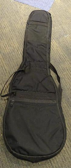 (SC) SOFT CASE GUITAR CARRYING BAG. HAS A SMALL HOLE IN THE BOTTOM OF THE CASE. ITEM IS SOLD AS IS