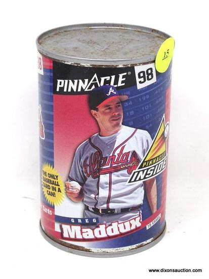 PINNACLE 98' BRAVES GREG MADDUX COLLECTIBLE CAN. HAS NOT BEEN OPENED. ITEM IS SOLD AS IS WHERE IS