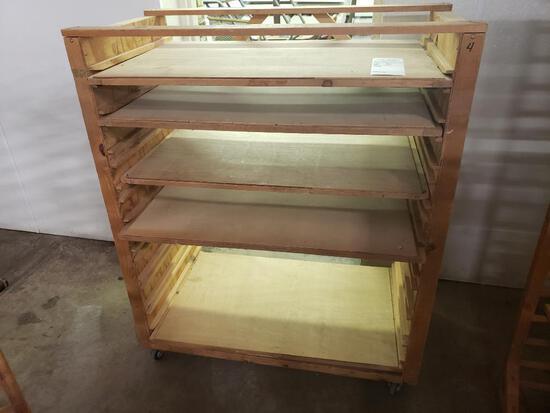 Wood rolling shelving unit.