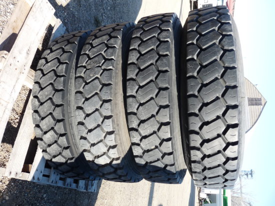 "(8) 10:00-20"" Grip Tires on Open Center Rims"