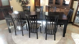 Modern Dark Wood Table and 8 Chairs.