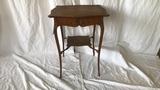 Light wood side table.