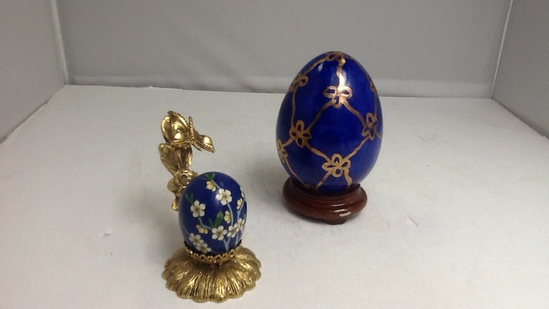 Lot of two blue painted eggs with holders