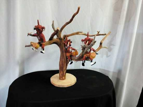 Kachina Dolls up in Tree playing drums
