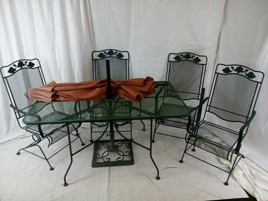 Green metal outdoor table umbrella and 4 chairs