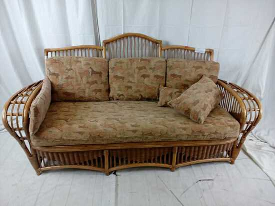 Bent cane sofa with horse pattern cushions.