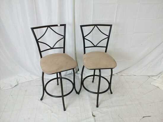 Pair of metal black and tan bar stools.