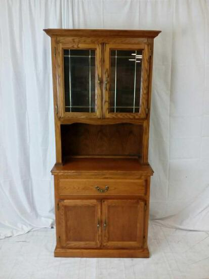 Two-piece oak china hutch with leaded glass doors