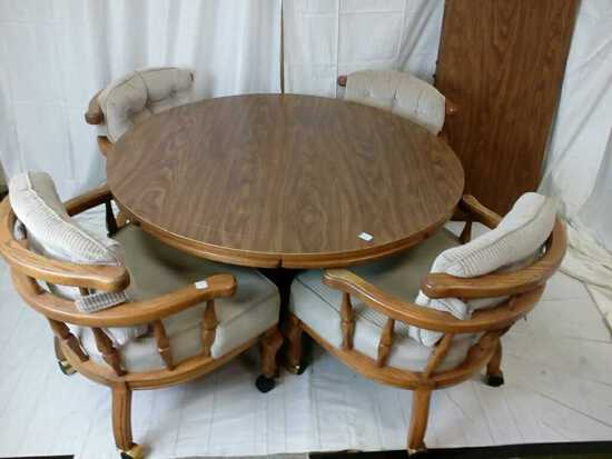 Round dining table with four chairs and two leaves