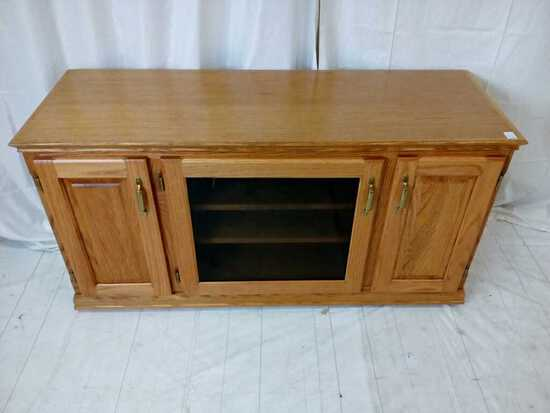 Light oak TV stand on casters