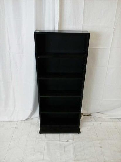 Small black pressed wood bookcase