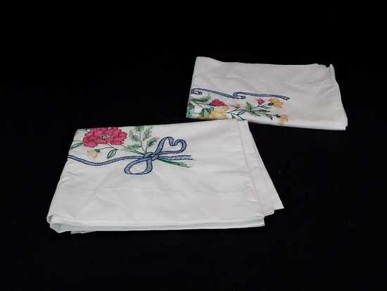 SET OF HAND EMBROIDERED PILLOWCASES W/BLUE RIBBON