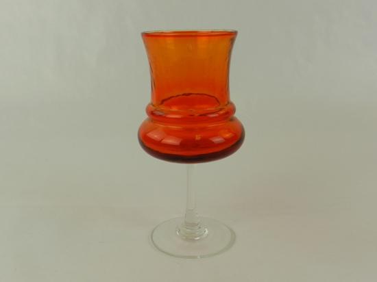 ORANGE GLASS CANDLE HOLDER ON CLEAR PEDISTAL