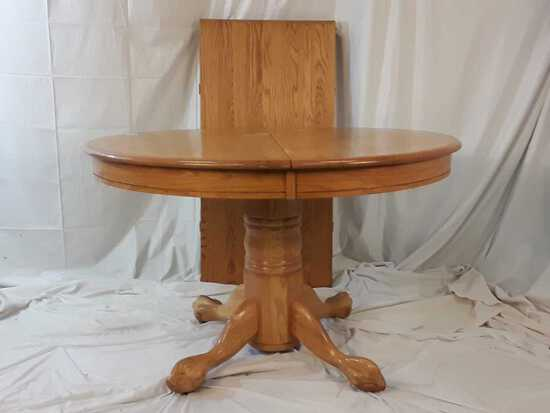 WOODEN ROUND TABLE W/LEAF CARVED FEET