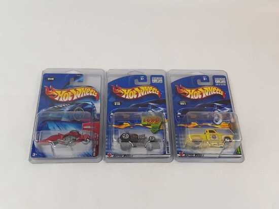3 HOT WHEELS NEW IN PACKAGE W/HARD CASES