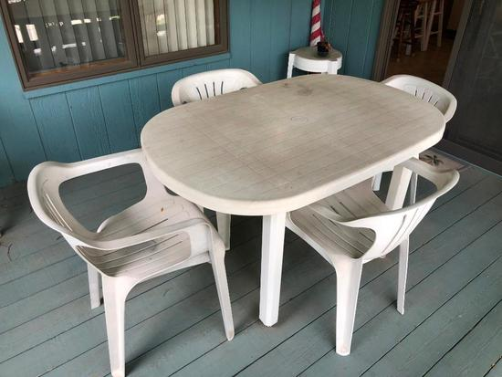 Plastic Patio Furniture, 8 Chairs, 2 Side Tables, and 1 Large Table
