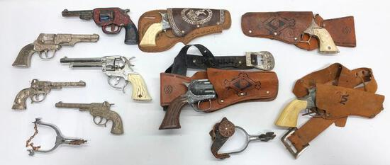 Hugh Lot of Vintage Toy Guns and Leather Holsters includes Toys Spurs