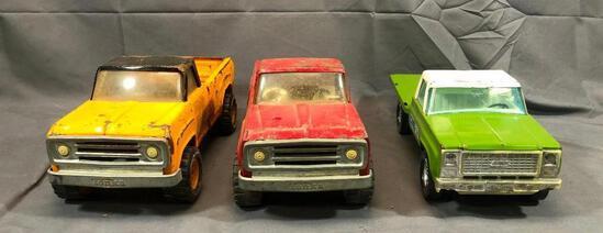 2: Tonka Pick up Trucker and One NyLint 14'' Long